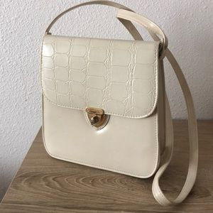 Vintage crossbody with faux animal flap